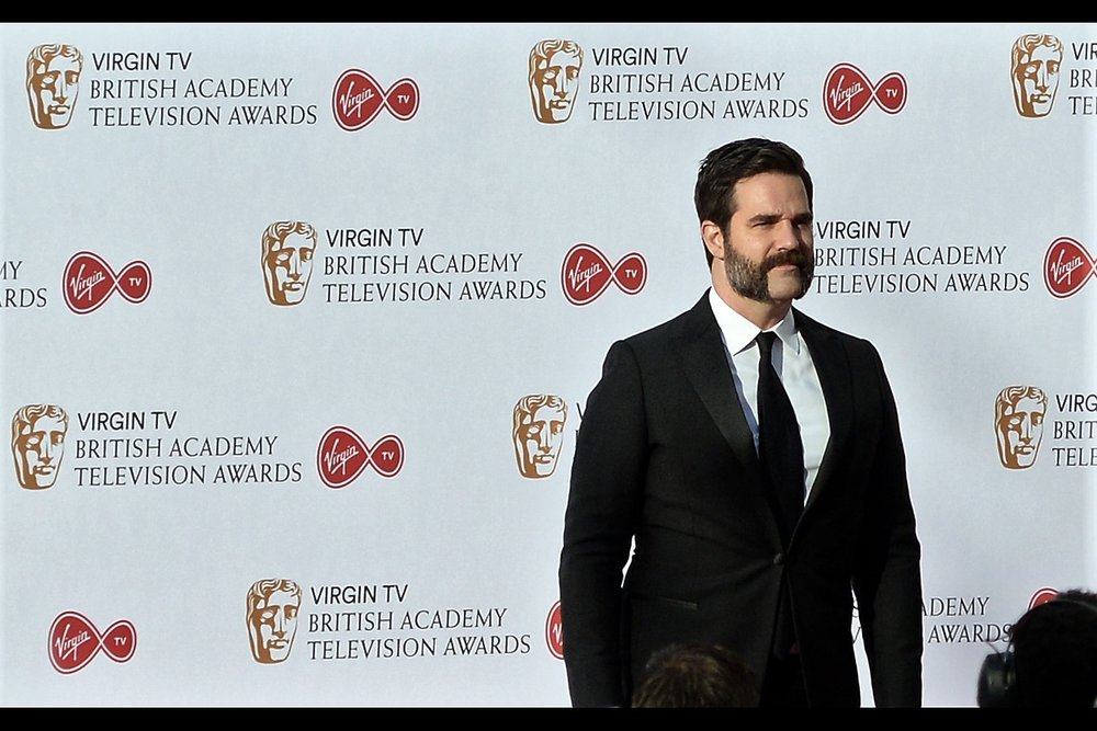 I don't know who Rob Delaney is, but I feel those sideburns need to be photographed regardless of who's wearing them.