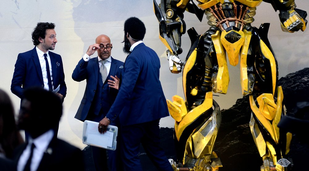 """Yes, Mr Tucci, we can confirm you're standing at the same level as Bumblebee's crotch as per your instructions"""