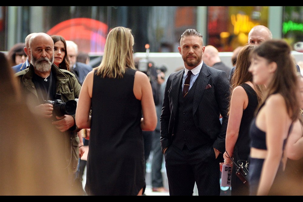 Not only is Tom Hardy better dressed than I am (though I am wearing a suit jacket over my yay-the-maroons-won-the-State-of-Origin-series-yesterday Maroon t-shirt), I still maintain that he owes me five dollars for that bet.
