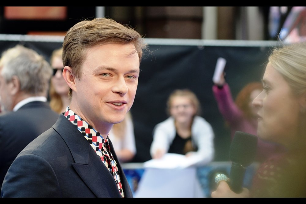 Dane DeHaan cleverly makes eye-contact with the one person in my immediate vicinity not screaming at him (me). I'm not sure whether that's still going to be true if/when Cara Delevingne takes his spot to be interviewed.