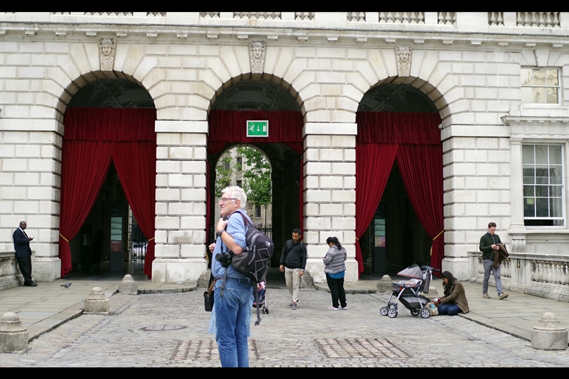 To make people feel special, Somerset House installed snazzy-looking red curtains at the north entrance of the open air cinema. And for no charge, American Tourists will stand right in front of your photo for longer than you could possibly imagine, just looking at a board to the left.