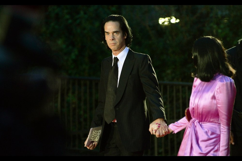 "This Is Nick Cave, And The Pink Dress Of The Person Whose Hand He's Presently Holding.  (edited to add: Nick Cave and the Bad Seeds won the ""Band"" award on the evening and given they released an album last year AND are Australian, I shall not be making fun of or minimising the scope of their accomplishment)"