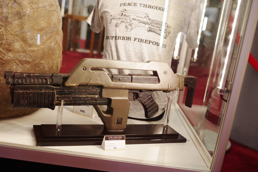 Aliens Pulse rifle : Damnit.. way back in the day I coulda bought a 1:1 scale replica with LED counter for about 1/50th of what this ended up selling for, but didn't. I certainly couldn't have afforded this.   (Winning bid for the t-shirt: £3,000!)