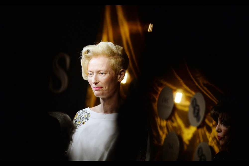 Tilda Swinton is being interviewed, and Joan Collins is surprisingly short.