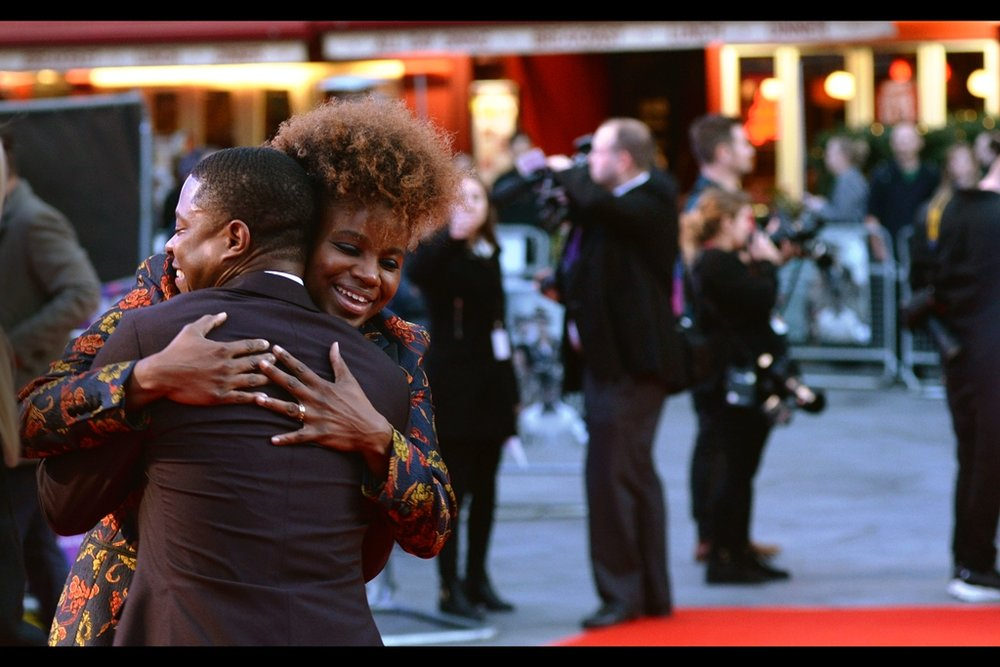 My spot in the front row of my public pen is highly susceptible to having views blocked from people within the pen as well as the world's tallest (and most likely to stand in the path of photographers) security guard. This is one of only two photos of director Dee Rees