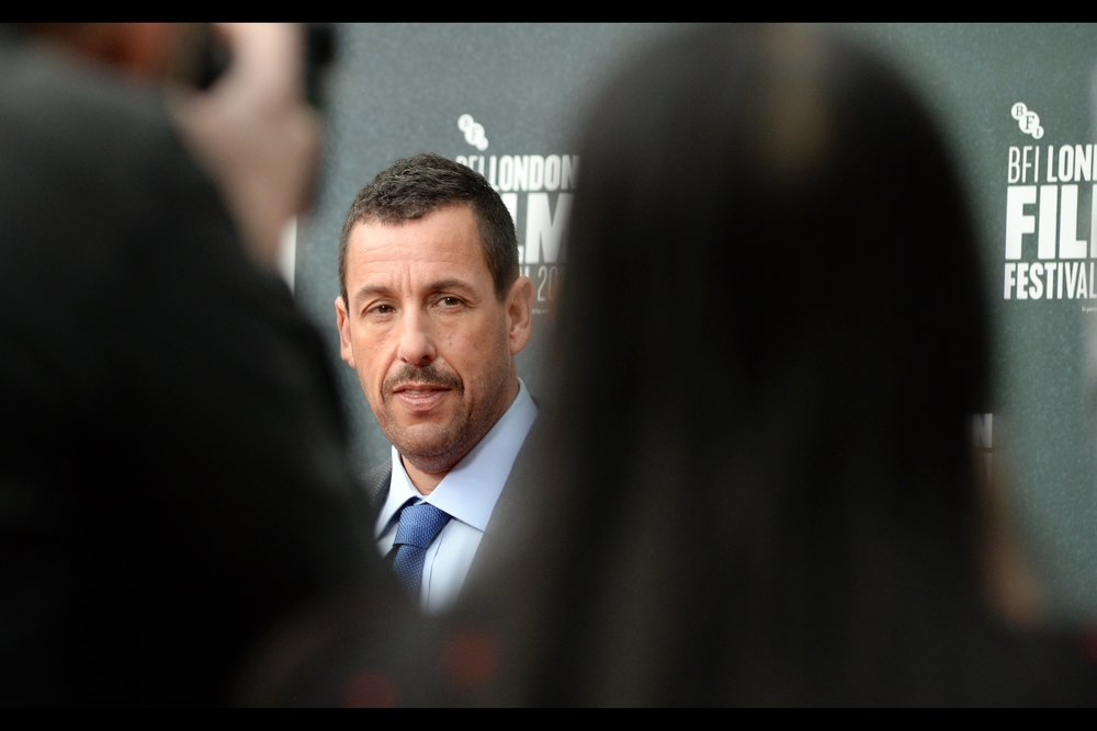 Adam Sandler, meanwhile, has escaped some of the bleating, braying and general hilarity of the fan/dealer pen gauntlet and retreated to the (relative) safety of the Paparazzi area.