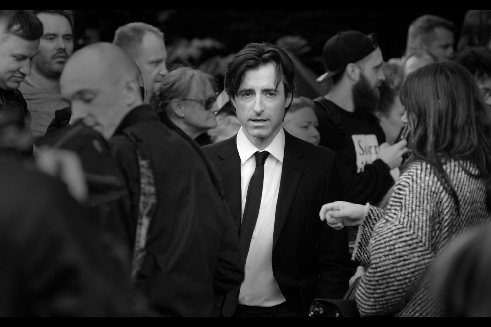 """Who are these people behind me? I feel like I'm in a Thriller music video, and no matter how old that reference is I assure you that you know exactly what I mean""  Noah Baumbach is the director of this movie"
