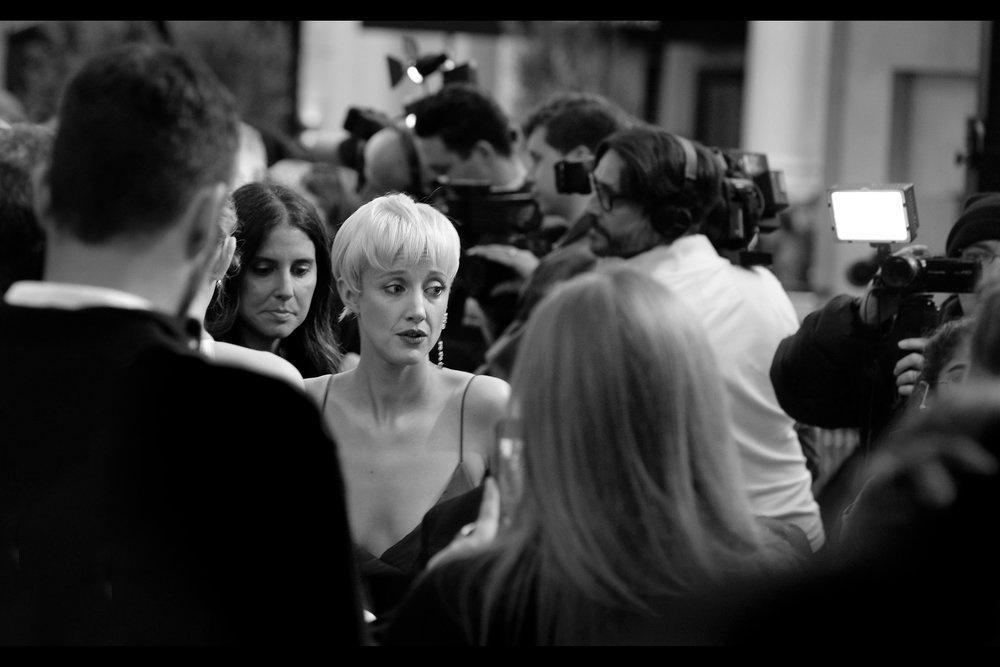 """I'm sorry - I can't sign anything featuring me from a prior hair-colour.""  I still can't get over how different Andrea Riseborough looks, to the point where I'm wondering I could plausibly say I'm Will Smith and I've just randomly shown up at this premiere"