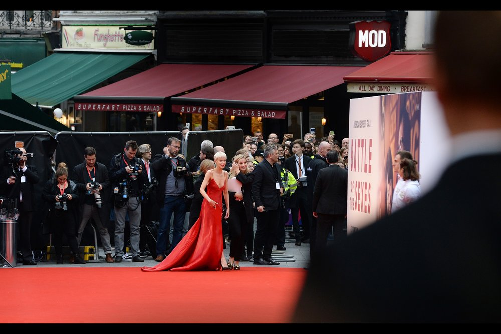 """Isn't there anywhere the carpet ISN'T red?"" ""I'm afraid not....""  Our first arrival : Andrea Riseborough, who looks very different now to how she looked in (say) the movie ""Oblivion"", or   the premiere of the Madonna-directed ""W.E."""