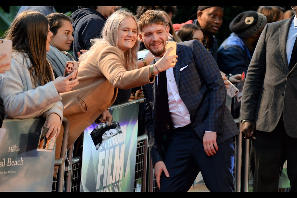 """I appreciate you hiding the photo of Saoirse Ronan and pretending to be excited to photograph me. I really do"" - Billy Howle is the male lead in this film, and his imdb entry reveals he was also recently in Christopher Nolan's ""Dunkirk (2017)"""