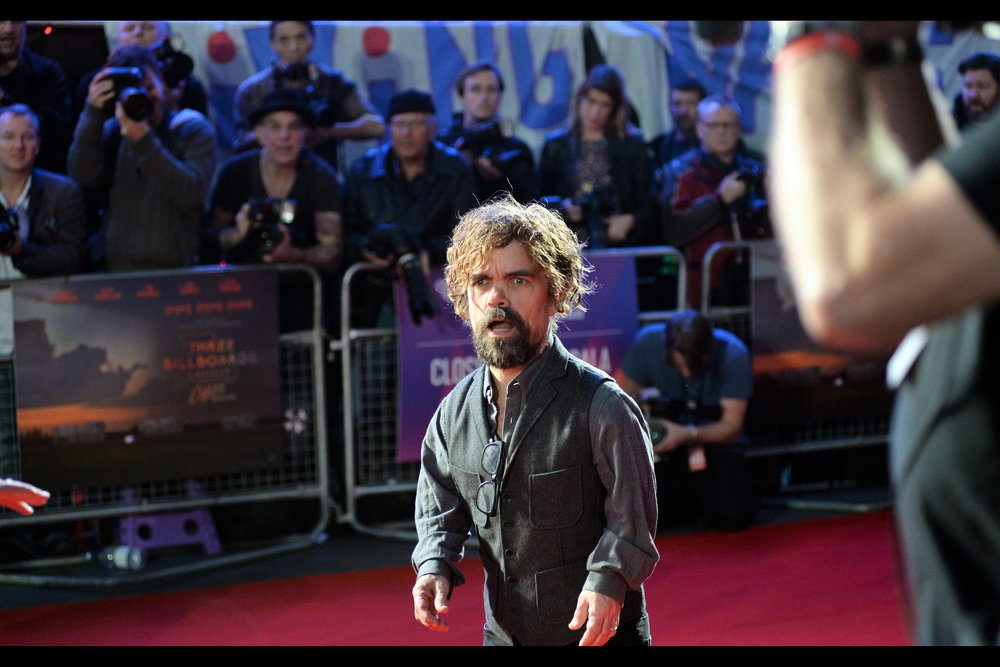 Peter Dinklage (a) is awesome, (b) the third of four people I really wanted to photograph at this premiere, and (c) has just read the hand-written sign from the cute Korean girl in our pen.