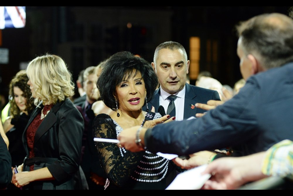 I do know who Dame Shirley Bassey is : she sung the themes to at least two Bond films - which is enough to get you onto the red carpet at a James Bond Royal World Premiere without having to queue all day for wristbands and be crash-tackled by security because the wristbands only give you access to the public pens and not the carpet.