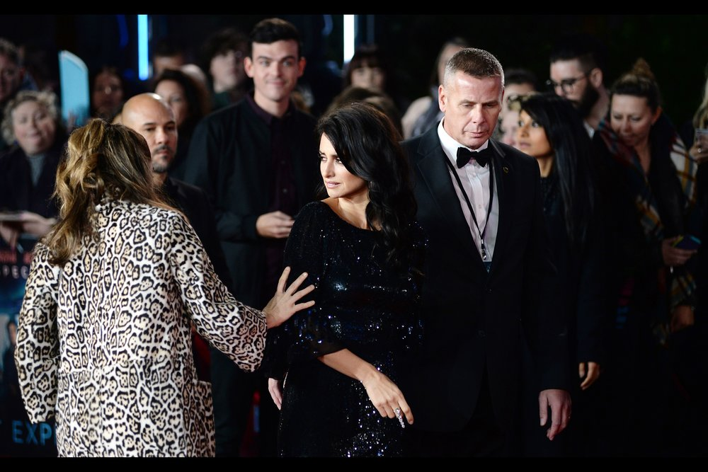 """Oh, to have chosen a slimming and shimmering black dress over this faux cheetah thing I'm wearing..."" ""I'm sorry... are you touching my arm while regretting that?"""