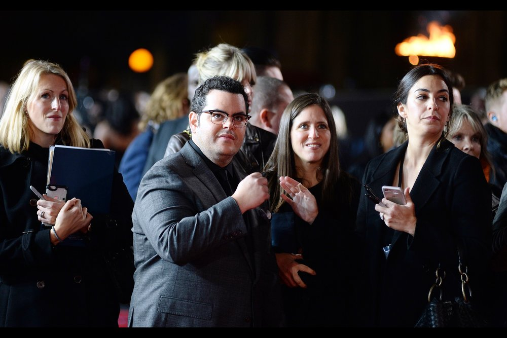 """Spontaneously discreet fist-bump?"" ""But I was going for a quiet low-five."" ""Damnit.. we need to co-ordinate this better""  - Josh Gad is in this movie and best known (arguably) as the voice of the snowman Olaf in Disney's 'Frozen'"