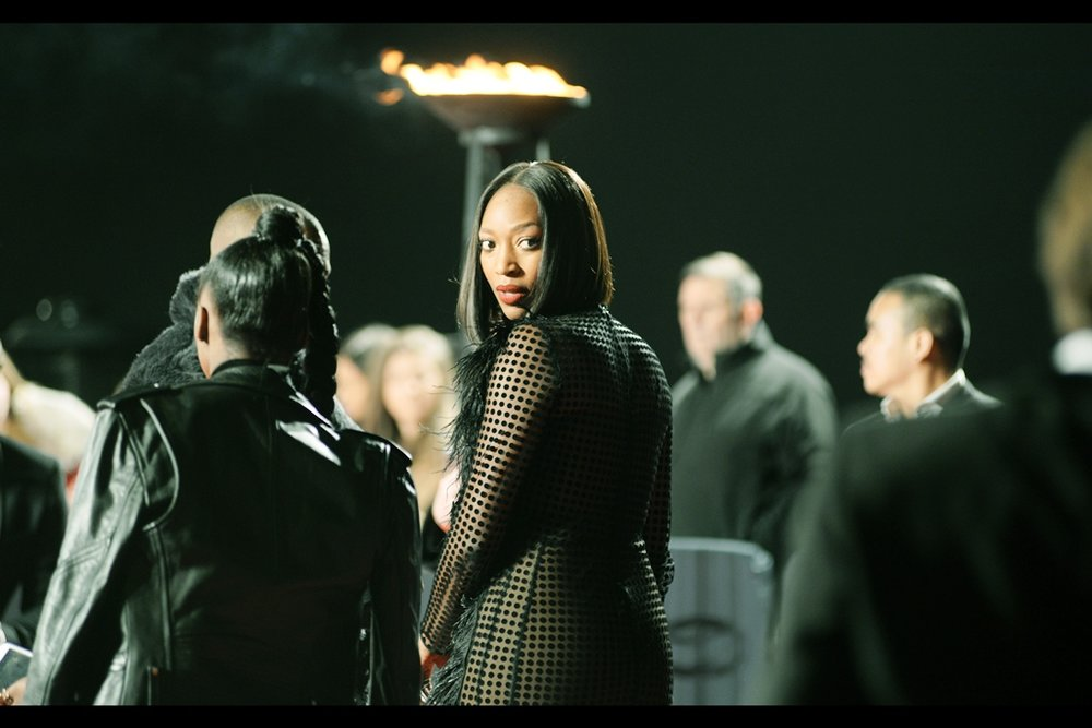 "<unknown, but implicitly denied being Naomi Campbell by declining to sign for people calling out ""Naomi! Naomi!!!!"". Weirdly, Naomi Campbell showed up later and explicitly declining to sign for people calling out ""Naomi! Naomi!!!!"" so it's all rather complex. >"