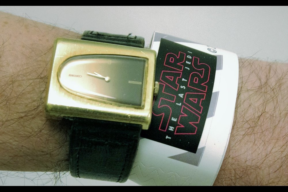 "T-Minus something like 26 hours... and it seems my plan to get into this premiere has worked. And although I publicly called 'The Force Awakens'    ""a work of craft and calculation but not art or love""  , which I totally stand by because it's 99% true... I've got a wristband for tomorrow's premiere. And I've got it one day early!  (and no, the watch is NOT for sale)"