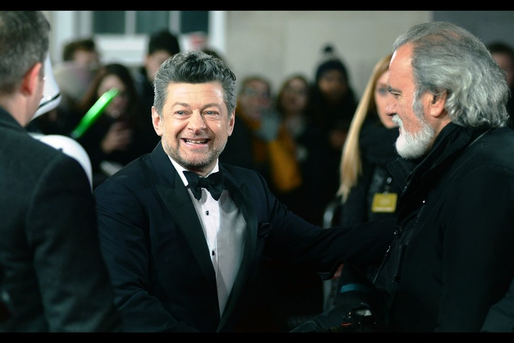 Andy Serkis plays some kind of CGI monstrosity in this film, or so I presume, given his characters never wear tuxedoes in films (though I haven't watched the last of the Planet of the Apes films, so I don't know if Caesar wears a tux in that)