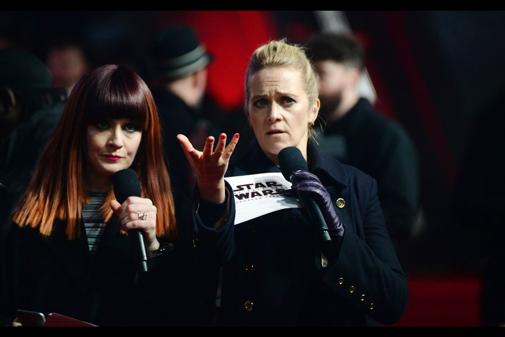 """Why was he holding up a shoe in that last picture... do we know?""  - performing on-stage and on-carpet interview duties at this event were Edith Bowman (right) and (I'm pretty sure I heard this correctly) ""Anna Matronic"" (left)"