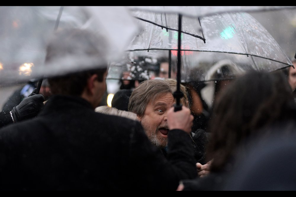 Fortunately, I have photographed Mark Hamill (better than this) at premieres and events such as    last year's GQ Awards    and last year's    premiere for Star Wars : The Last Jedi   . And yes, absolutely, I feel that it requires at LEAST four Umbrellas in London to keep the snow off Mark Hamill. And the umbrellas should be held only by the tallest security guards on the payroll.