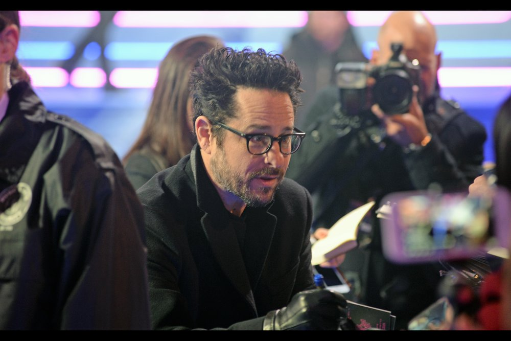 """""""You've got ideas for Star Wars 9? Hell yeah I want to hear them - we start filming this year!""""  - surprise attendee at the premiere : JJ Abrams, who directed Star Wars Episode 7, had most if its ideas and setups summarily discarded by Rian Johnson in Star Wars Episode 8, and surprisingly agreed to direct Episode 9, possibly to explain that most of The Last Jedi was a dream."""