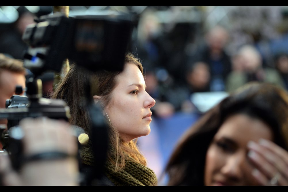 "The camera lady is certainly pretty, but from where I sit a few hours later, I almost wish I'd focussed more on the foreground, at the lady with the  ""but whatever shall I do if Michiel Huisman doesn't show up?""  expression of imminent despair."