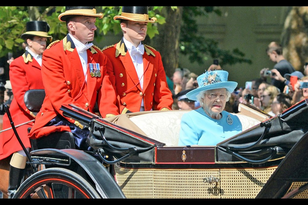 """The Leg Room is even better this year...""  It's the Queen!! Her husband Prince Philip (who turns 97 tomorrow) retired from public appearances last year, so she rode alone in her carriage."