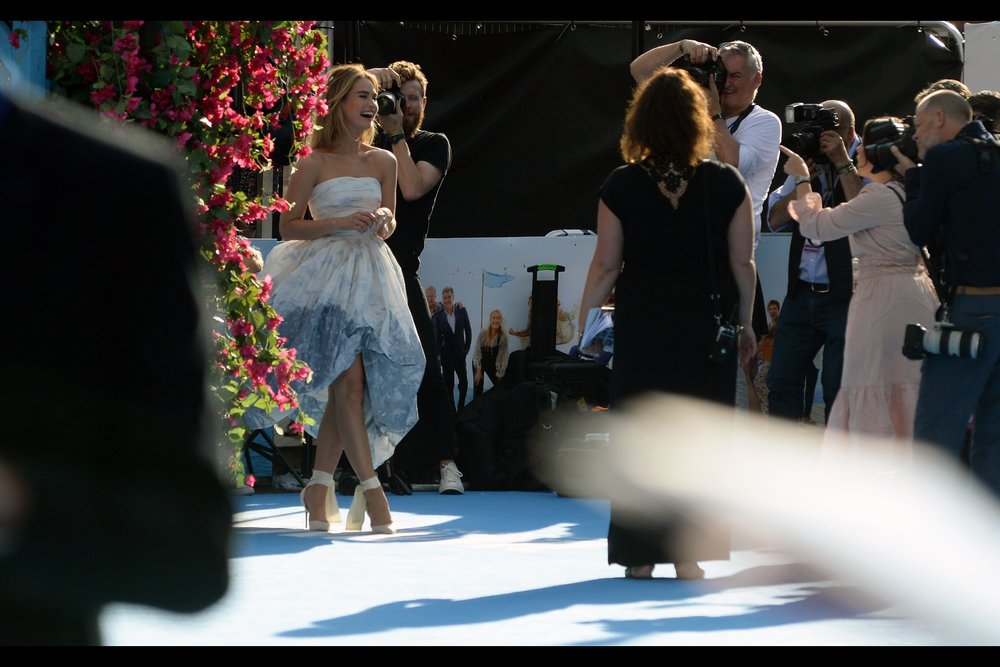 """It's Lily James! I like her. And that is all. (I think I most recently photographed her at this year's marquee-busting-titled    """"The Guernsey Literary and Potato Peel Pie Society"""" premiere   . But she was also    """"Cinderella""""    in the live-action movie AND the female lead in the even better    """"Pride & Prejudice & Zombies"""""""