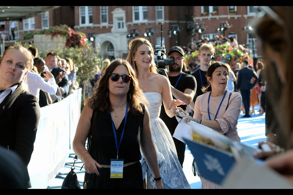 Lily James buzzes past en route to the stage, and promises to return. Many say that, but few do. Then again, she's lovely.