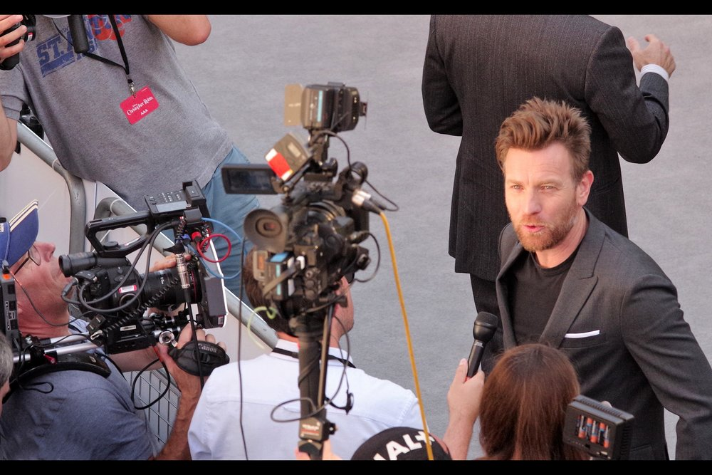 """""""Oh, yeah. Those films. I barely remember them"""" . It's Ewan McGregor! He plays the role of Christopher Robin in the film, and I am both stunned and happy that according to imdb.com, the #1 movie he is 'best known' for is """"Moulin Rouge"""" - with the Phantom Menace a mere #4."""