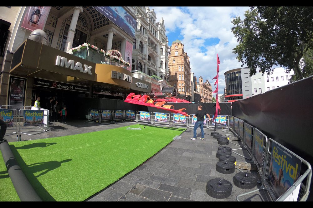 A green astroturf carpet for a Music Festival-themed movie. Not provided for added authenticity - mud, long queues at chemical toilets, questionable hygiene, and exorbitant prices for hamburgers of questionable quality. It's been years since I last went to a festival but these are what I remember.