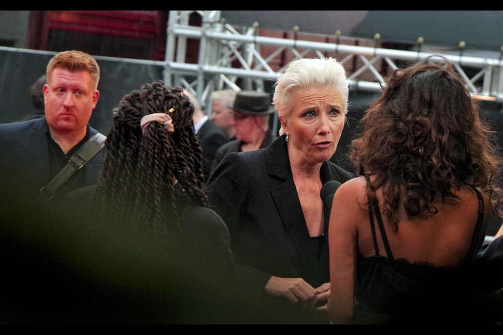 Emma Thompson remains one of my very favourite people to photograph. For ... obvious reasons. Man in background is compelling, though.