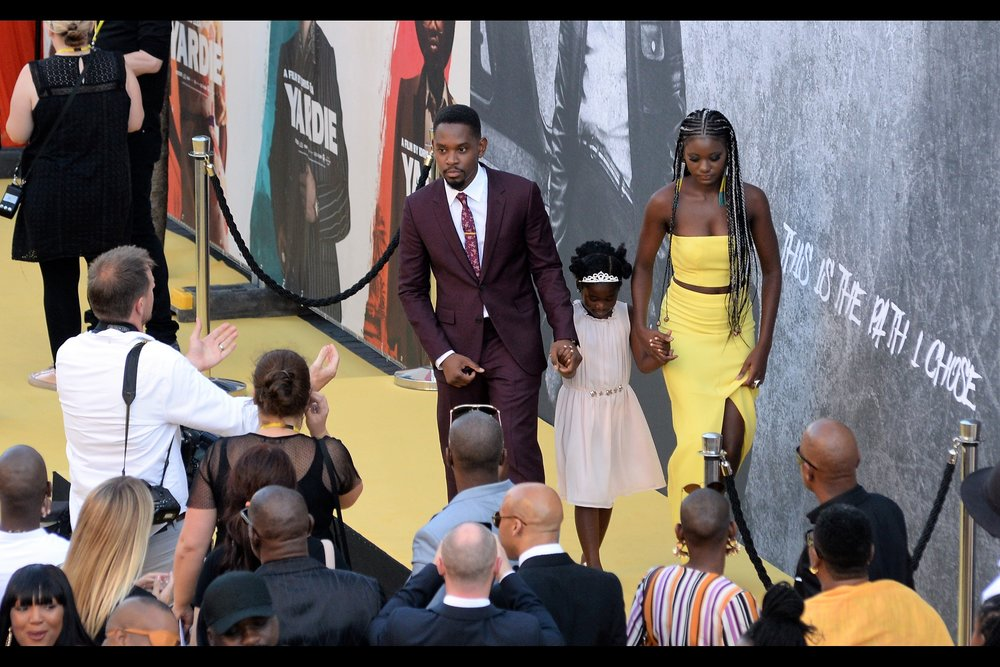 "Photographer at left be all :  ""Hey, could you guys TRY to act more like a family??""  And Aml Ameen be all :  ""We're barely talking to each other, passive-aggressively seething and laying the groundwork for years of resentment... .we couldn't be acting MORE like a family"""