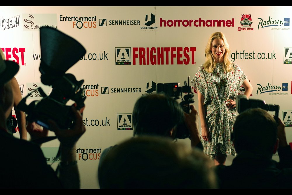 Then again... that dress Caitlin Fitzgerald is wearing is kind of quirky....