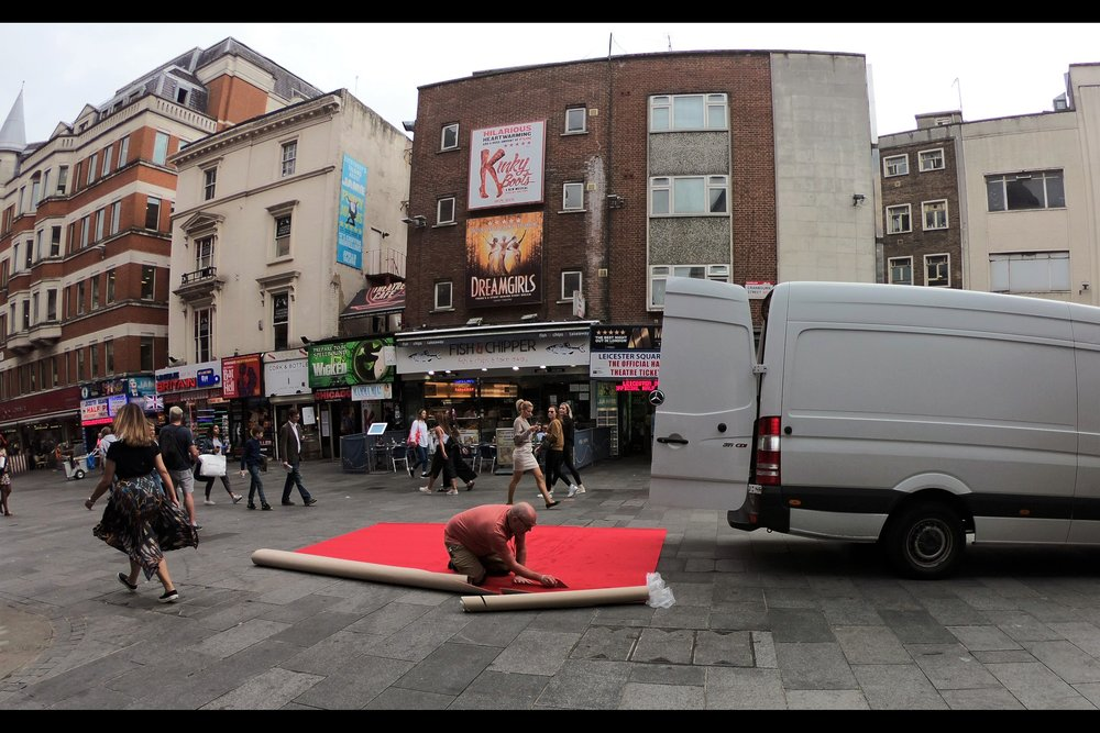 No, they're not putting square of red carpet onto the major walkthrough to Leicester Square and calling that a premiere - yet - but the polished floors of the Vue Cinema behind me probably don't take kindly to knives being used to cut red carpets on them.