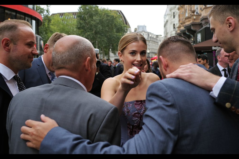 Who knew complimenting a girl's dress could earn you a grateful fist-bump? Sadly I can't take Stefanie Martini up on the implied offer as I'm not really capable of fighting my way past five or six guys (one or two who might be security) for it. I'm cowardly and/or stupid like that.