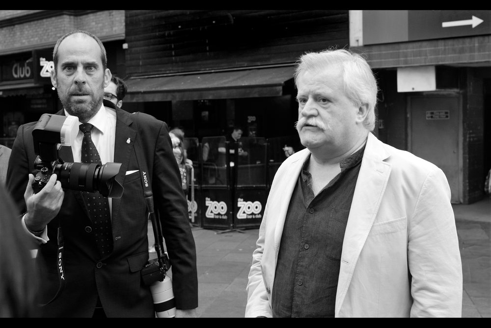 This is possibly less a photo of two-time TV Bafta winning director David Blair (right) as it is the lone outdoor photographer (left), looking shell-shocked at brazen dealer behaviour. I didn't want to break it to him that he's not even getting the dealers' second reserve team at this event.