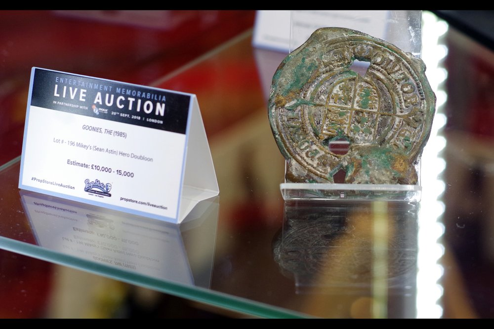 """A lot of work went into making it look old. If it was in better condition it would be cheaper I'm sure...""  Goonies Medallion. Winning bid: £25,000"