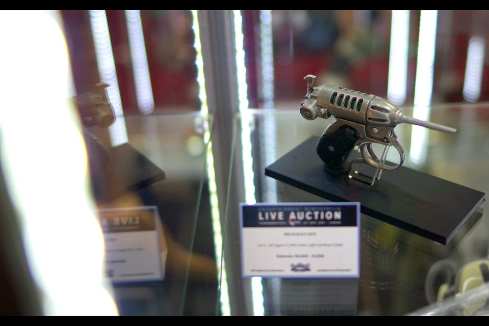"""Hold still… as long as you've already suffered extensive nerve damage you won't feel a thing""  Will Smith's Noisy Cricket gun from Men In Black. Winning bid : £13,000 !"