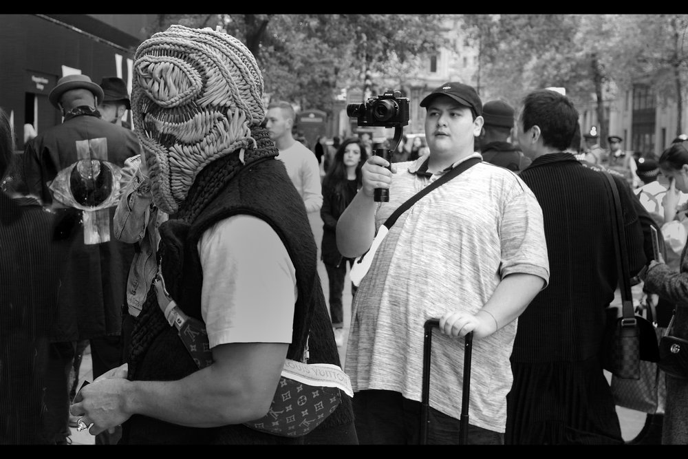 """Nah, bro. I totally dig your 'art'. Doesn't intimidate me one bit""  By the way, for those of you running your own sweatshop operations at home, that head-covering the guy is wearing goes ALL the way around the head. I did not see any evidence of eye-holes."