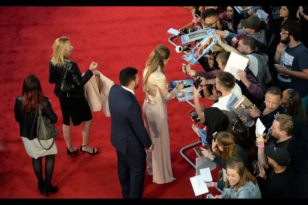 Blake Lively also has a lady who holds an additional satin-y jacket just in case she needs some variation in stylishness. I did bring my LA Dodgers baseball cap to this premiere… but I'm also currently not wearing it.