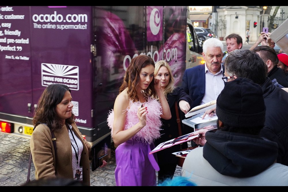 OMG. The first in-focus photo of Olga Kurylenko happens when a PASSING F**KING TRUCK momentarily freaks out the Pentax's autofocus, causing it to more or less randomly panic and leap to the actress' face. Needless to say, the autofocus moves on scant frames later.