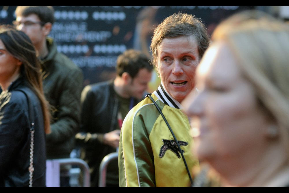 """It's Frances McDormand! - she won an Oscar (and was at last year's BFI London Film Festival Closing premiere) for """"   Three Billboards Outside Ebbing, Missouri   """". She's married to one of the two Coens (… Joel?) and after exactly three rapidfire shots from the Nikon, the fat-faced lady in the foreground blocked further shots where she was facing in my direction until…."""