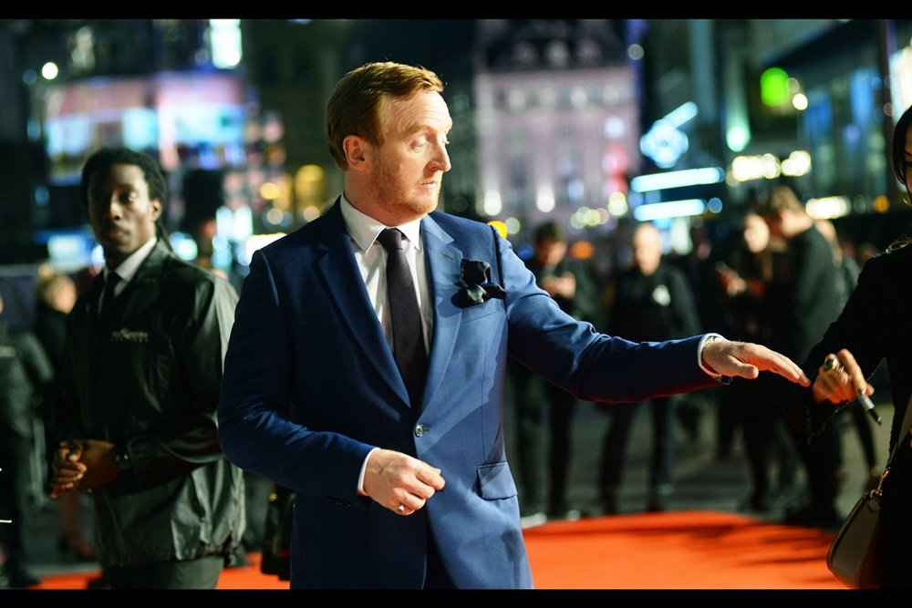 """This is how they do high-fives in Hollywood now, I'm told"".  Tony Curran has a long and storied imdb entry which includes an Underworld film, the TV Series '24', six episodes of something called 'Crazyhead' and something called 'two-headed rat bastards'."