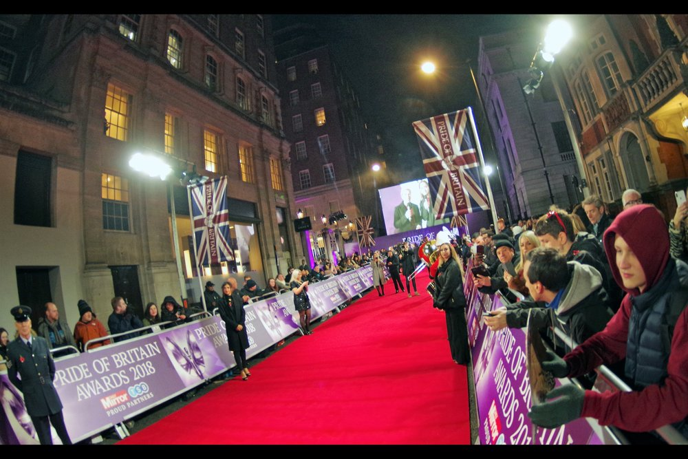 The realities of organising a complicated event consisting of one long red carpet meant that while my original wristband #87 earned me a spot in the front row of corner dropoff, I/we were all ultimately told to move and I ended up front-row, mid-carpet, in a pen of (Proud and British) autograph dealers.