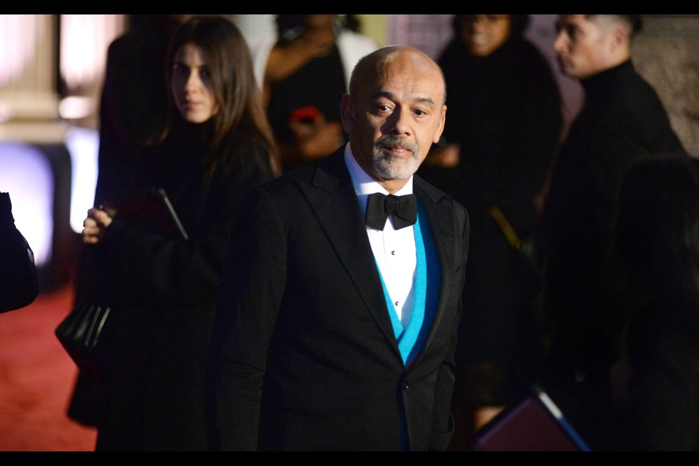 """You're wearing a hoodie and want me to come over there and sign? Let me guess… at BEST you're wearing Lynx Africa deodourant….""  - Christian Louboutin is a famed fashion designer. I believe his are the high heel shoes that have a red base underneath."