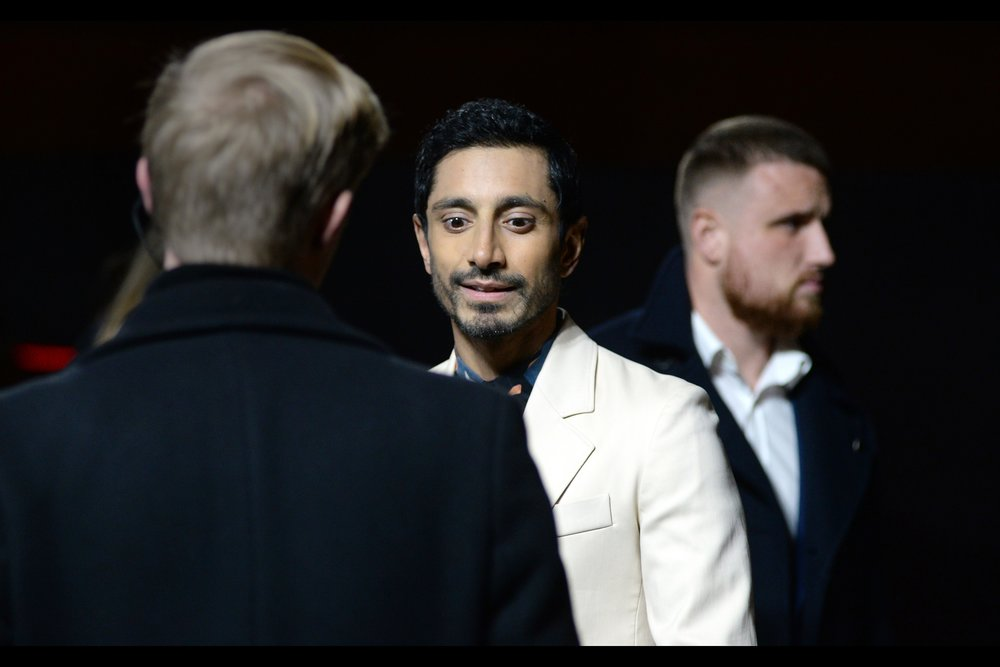 """Okay, now I'm thinking maybe shoulderpads should make a comeback""  - Riz Ahmed is possibly still best known for being in Rogue One, one of only two premieres where a Pentax didn't survive the evening (and the only one where it was deliberate)"