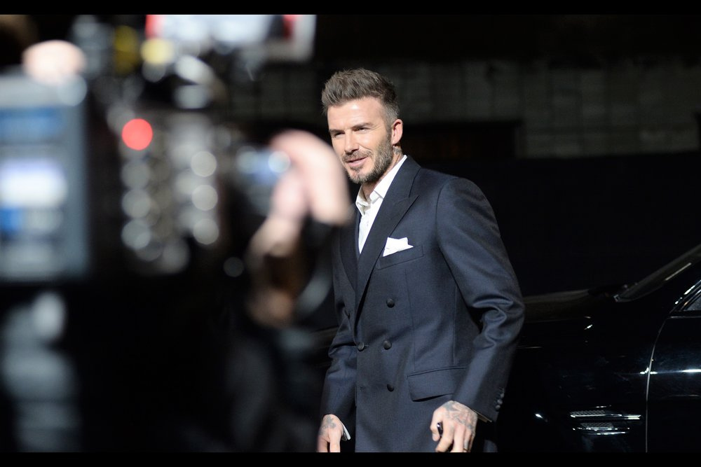 It's David Beckham! If you know him, please don't tell him about the metaphorical lifetime I spent with Victoria while he walked three or four steps from the car door to where he is now.