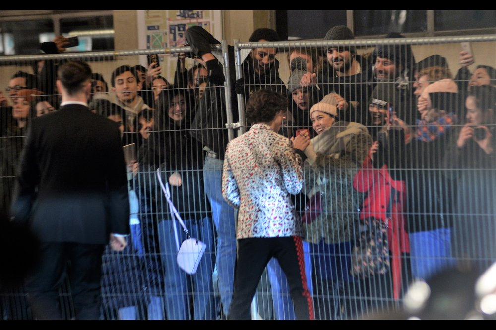 """Oh, if there was but no fence dividing us that stretched yonder for no more than five or six metres, we would be together right now, my darling!"" -  AND Timothee Chalamet crossed to the other side of the road to greet fans too. Impressive."