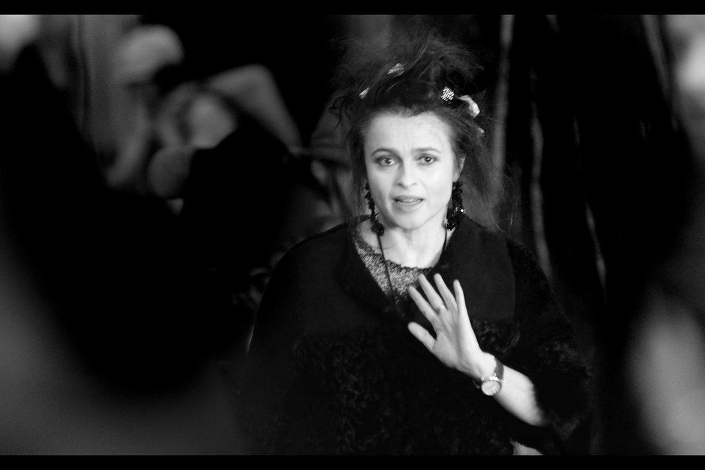 """This is how all the cool kids wear watches, now that they put the time on mobile phones..""  Special guest at this premiere : Helena Bonham Carter, whose connection with Ralph Fiennes (outside of the possibility that they're actually friends) is that she was also a death-eater under Voldemort as Bellatrix Lestrange in the Harry Potter films."