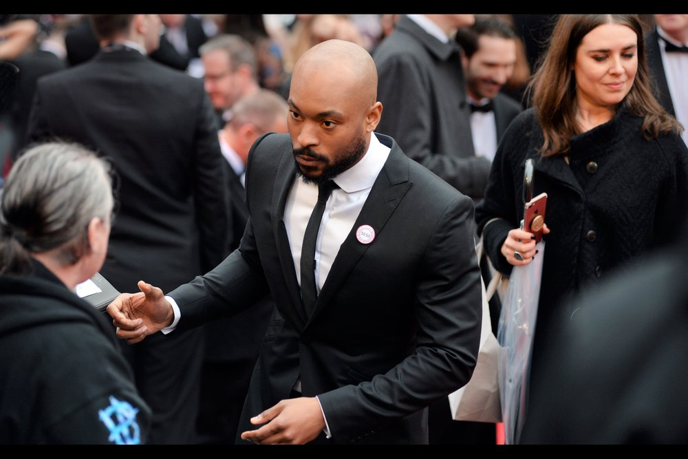 Arinze Kene is in The Theatre - I've photographed him at numerous Evening Standard Awards (which is my substitute for actually going to the theatre), which is why I know this.